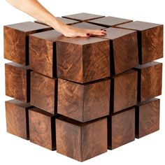 """The Float Side Table is a piece of furniture that is at once classically balanced and technologically moving. This piece is constructed from a matrix of """"magnetized"""" wooden cubes that levitate with respect to one another. The repelling cubes are held in equilibrium by a system of tensile steel cables. It's classical physics applied to modern design. Each handcrafted table is precisely tuned to appear rigid and stable, yet a touch reveals the secret to Float's dynamic character."""