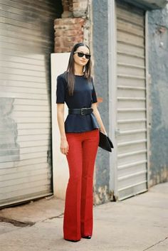 Stylish red trouser with black top and waist belt