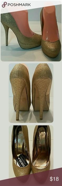 """NWT's Gold Dust Platform Stiletto Pumps Size 9M PMTC-0183  NWT'S platform pumps. 6"""" stiletto heels. Platform is 1.25"""" at their highest point.  The shoes are size 9M. The inside measurements from toe to heel are 9.75"""". All measurements approximate.  **No box** Shiekh Shoes Heels"""