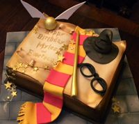 3d harry potter book cake with glasses, sorting hat, scarf , gold stars and glitter