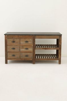 "DETAILS  With six roomy drawers that open from both sides and two slatted, open shelves, this reclaimed pine and blue stone island provides ample storage and counter space in kitchens where one or both may be lacking.   Six drawers, two shelves   Blue stone, reclaimed pine   33.5""H, 65""W, 27.5""D"