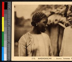 Two young women conversing outdoors, Madagascar, ca.1920-1940 :: International Mission Photography Archive, ca.1860-ca.1960