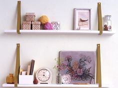 "SHELVES :: DIY Ribbon Bracket Shelves :: 1. Bring ends of a 1""x36"" grosgrain ribbon together; fold ends over twice. Screw gun folded ends to wall. 2.) Slip a 1x6"" painted plywood shelf into ribbon loop, so ribbon is at least 3"" in from shelf end. Have someone hold that end, then slide other end into a 2nd ribbon loop; using a level, affix 2nd ribbon to wall. Adjust shelf inside ribbons. 3.) Secure ribbons under shelf w/ staple gun. Use shelves for lightweight objects. 
