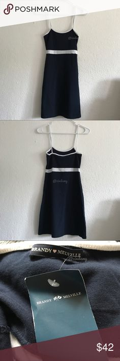"""Brandy Melville Lillian navy dress Fitted mid thigh length spaghetti strap dress in navy blue with a white stripe under the bust and white strap detailing. NWT (NEW WITH TAGS)  Fabrics: 100% cotton Measurements: 31"""" length, 13"""" bust (stretches) Made in: Italy Brandy Melville Dresses Mini"""