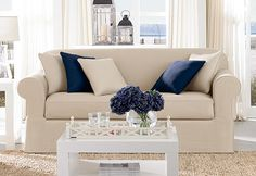 Photo of Twill Supreme Separate Seat Slipcovers from Surefit. Sofa is $120 and chair is $90