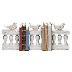 Give your bookcase, desktop, or tablescape gallery-worthy design with the 3 Piece Bird on Fence Bookend Set. These timeless pieces are finished in distressed cream, showcasing a charming spring courtyard design for eye-catching appeal.   Product: 3 Bookends   Construction Material: Resin   Color: Cream   Features:  Distressed finish   Eye-catching design   Size: 9.75 H x 3.37 W x 17.12 D   Cleaning Instructions: Wipe clean with damp cloth