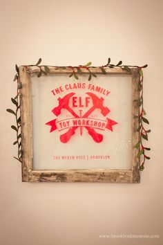 DIY Rustic Sign made with an old window and a red sharpie | Elf Workshop Window Sign | www.brooklyn.com