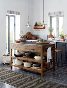 Like a treasured vintage find or a custom-designed piece, this elegant kitchen island serves as a rustic yet refined workstation for the home cook or entertaining enthusiast. Bluestone is crafted with reclaimed pine from old buildings and doors and a lustrous slab of bluestone. by roxanne