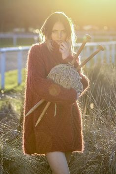 Is she pouting the sexy look and holding a giant ball of wool? What a fucking weird picture!