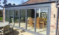 We provide high performance upvc and aluminium conservatory bi-fold doors that are designed to give consumers a technically innovative conservatory bi-fold doors product that has become the market's 'must have' product of today Garage Doors Uk, Bungalow Extensions, Kitchen Extensions, House Extensions, Lean To Conservatory, Garage To Living Space, Living Spaces, Living Room, Glass Extension