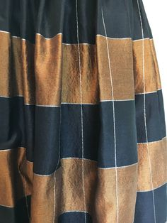 A personal favorite from my Etsy shop https://www.etsy.com/listing/539411891/vintage-1950s-copper-and-black-circle