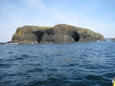 "Fingal's Cave ( or ""the Cave of Melody"") is a sea cave located in Scotland, on the uninhabited island of Staffa."
