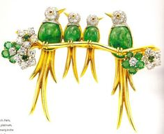 AN EMERALD AND DIAMOND BIRD BROOCH, BY VAN CLEEF & ARPELS Designed as four birds with cabochon Emerald bodies, cabochon Ruby eyes and pavé-set Diamond heads, perched on a polished Gold branch, enhanced by circular-cut Emerald and Diamond flowers, mounted in 18k Gold, with French assay marks and jeweler's mark for Van Cleef & Arpels. Signed Van Cleef & Arpels, nos. 1249CS and 5141