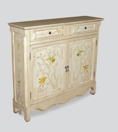 """Aviary Cabinet    A fresh, whimsical cabinet induces happy thoughts while offering versatile services. For foyer, kitchen, family room, sun porch, bed room...the flock of hand painted birds will make your heart sing in any room! French Ivory with antique finish. Pendant Knobs on cabinet doors. One shelf. Two drawers. 37 x 41 x 11""""."""