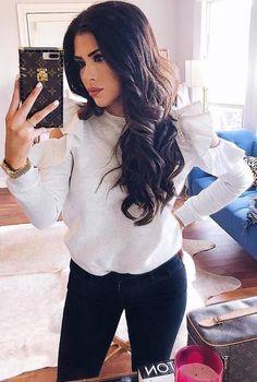 white top, dark jeans