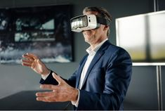 Mature businessman wearing VR glasses in office The Marketing, Online Marketing, Digital Marketing, Tech Stocks, Ways To Be Happier, Customer Experience, Stock Photos, Trends, Tops