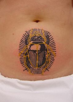 Scarab beetle tattoo by Xoil.  I love his layered effect.