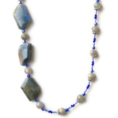 Labradorite is a beautiful natural semiprecious stone, gray with light-blue highlights. Three gorgeous free form labradorite nuggets are the focal point of this long unique asymmetrical necklace. The smaller labradorite rounds give highlights of their own. I have added some small blue crystal beads to pick up the blue color. This necklace is truly one-of-a-kind, and it will add a festive and elegant touch to your outfit!  It is 26 (66 cm) long.  Looking for a special occasions necklace?…