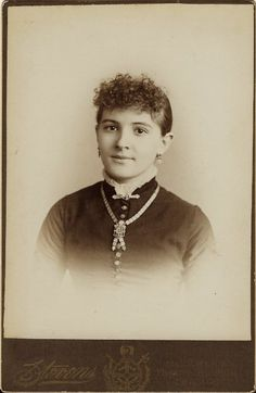This cabinet card portrait of a pretty teenage girl is by esteemed Chicago photographer John Kimball Stevens.