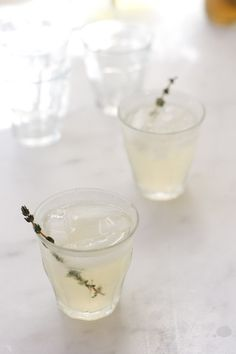 Lemon Thyme Gin Sparkler   QUITOKEETO: Make simple thyme syrup with 2 c. water, 1 c. sugar, 3 T fresh thyme to a simmer for a few minutes. Remove from heat and let sit for 10 min. Strain. For each drink, combine 2 T gin, 1 T fresh lemon juice, 2 t thyme syrup. Add ice cubes, stir and top off with 3 T soda water or tonic.
