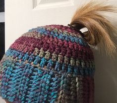 A personal favorite from my Etsy shop https://www.etsy.com/listing/484198834/ponytail-hat-messy-bun-hat-ponytail