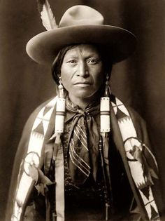 Here for your perusal is an original photograph of a Jicarilla Cowboy. It was created in 1905 by Edward S. Curtis.    The photograph presents a Half-length portrait of a Jicarilla man wearing traditional Indian clothing, and a Cowboy hat. It is interesting to note that he is wearing a feather in his hat, perhaps as an indication of heroic acts in his past.    We have compiled this collection of photographs mainly to serve as a valuable educational resource. Contact curator@old-picture.com.