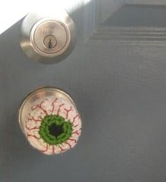 crocheted eyeball door knob cover. Oh yes!