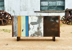 "RE:WRECK Sideboard by Iannone Design. ""Iannone Design is proud to have collaborated with Joel Hester of the The Weldhouse for this piece using salvaged automotive metal panels. Each piece of metal is hand selected by Joel and has a unique patina so no two pieces are alike. Soft closing doors with 2 adjustable shelves inside."""