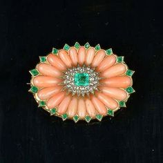 A late Victorian coral, emerald and diamond brooch