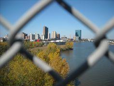 Downtown Toledo from chain link peek atop High Level Bridge.