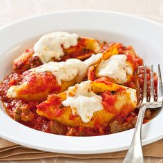 Reduced-Fat Stuffed Shells With Meat Sauce Recipe - Cooks Country