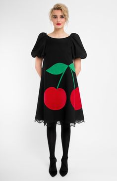 A-shape true wool dress with bottom lace finish. Boat neck. Balloon sleeves. Decorative cotton velvet cherries and three-dimensional woolen leaves. Hidden back zip closure. Without pockets.