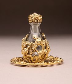 ☆ Gold Victorian Tear Bottle with  Matching Tray -The tear catchers, usually used by a widowed bride. Upon the day of the funeral, the widow would collect her tears into this small vile, and all the tears she cried in the first year over the loss of her husband, she would capture in this vile and on the anniversary of his death, she pours the preserved tears atop his gravesite. It's beautiful, tragic, and prolongs the suffering for ritualistic purposes. It's quite poetic.☆