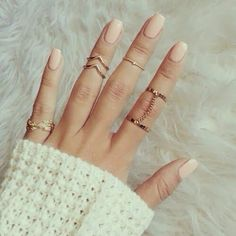 Love the knuckle rings and nude color nails