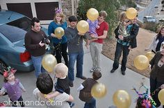 Instead of lanterns (because they can cause fire), golden balloons with glow sticks or those little led lights inside.