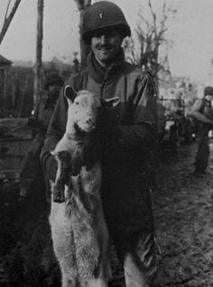 A Lieutenant of a supply company of the 329th Infantry Regiment/83rd Infantry-Division (Thunderbolt Division) with the company's mascot, goat Willie at Schevenhutte near Aachen/Germany.
