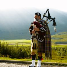 Piper near Bridge of Orchy in Argyll.    photo by John Low