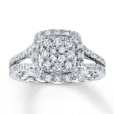 Round diamonds surround a center of four princess-cut diamonds and provide maximum brilliance to the sides and band of this charming ring for her. This fine jewelry ring is styled in 10K white gold and has a total diamond weight of 1/2 carat. Diamond Total Carat Weight may range from .45 - .57 carats.