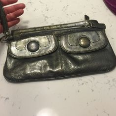 Nordstrom wristlet silver. Lots of pockets and zippers to hold everything. Bags Clutches & Wristlets