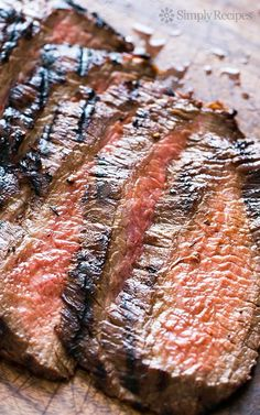 Grilled Marinated Flank Steak ~ A melt in your mouth flank steak that is cooked quickly with a high heat.  The marinade of soy sauce, honey and garlic does the trick for this cut of meat. ~ SimplyRecipes.com #grillingrecipes