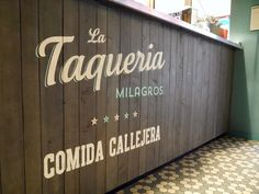 Painted logo for La Taqueria Milagros - Unexpected Street Food - Mexican in Munich