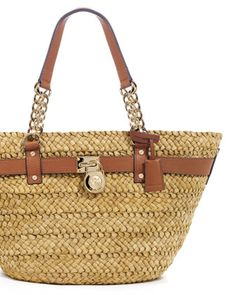 MICHAEL Michael Kors  Summer Tote...I imagine myself carrying this to a tropical location where I lay under a palm tree....until it gets dark:)