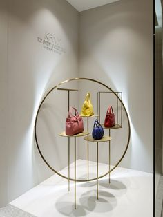 Kwanpen's handbags stand out from neutral stone displays