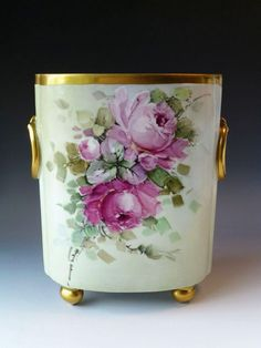 This pretty French Limoges cache pot measures tall and 4 by 7 across the top rim. It's hand painted with roses in the impressionist style,