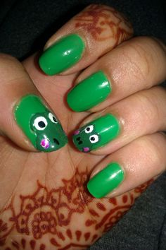 Frog nail art..tee hee. Just might do these..teaching about frogs next week with my class!