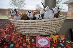 "At this doggie-themed birthday party, they set-up an ""Adopt a Puppy"" table as a #partyfavor for guests. Too cute!"
