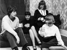 Mick enjoys a cup of tea with his female fans. Around 1964/1965.