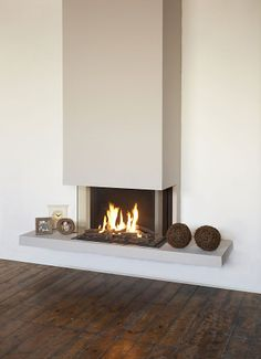 I like how the top plaster cuts in very simple I dont like the float Ortal | Ortal Clear 70 Three Sided Glass Gas Fire