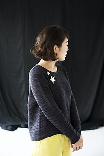 A top-down A-lined pullover with curved lines running across the body and sleeves. The construction is simple yet interesting, using