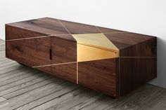 Anamorphic Console by Asher Israelow. First found in the 15th Century, anamorphic projection was used to pass secret messages or obscure visions within paintings. Now solid walnut and brass inlay compose hidden geometries. The first piece in a new vision of handcrafted furniture.